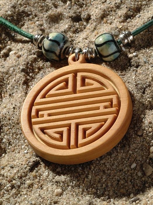 Amulet Shou teken laten maken